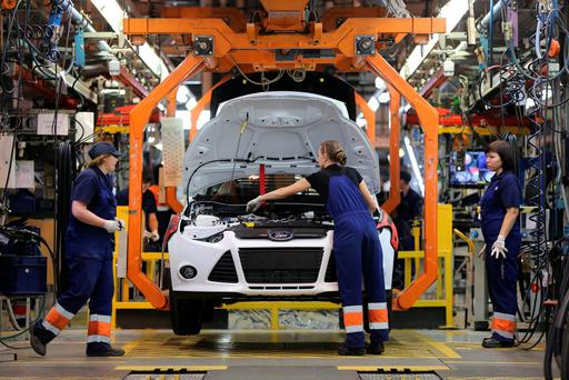 Assembly line workers at the carmaking giant's production facility in Vsevolozhsk, Russia, as UK and Germany face jobs losses. Photo: Bloomberg