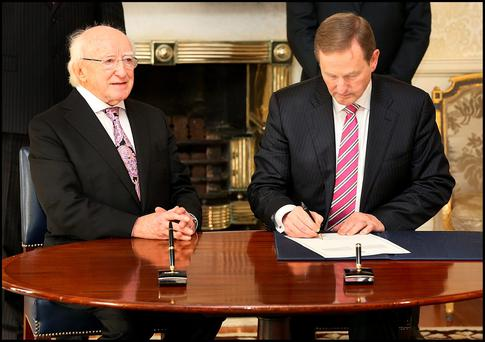 President Michael D. Higgins and Taoiseach Enda Kenny at the Aras An Uachtarain where the Dail was dissolved. Photo: Steve Humphreys