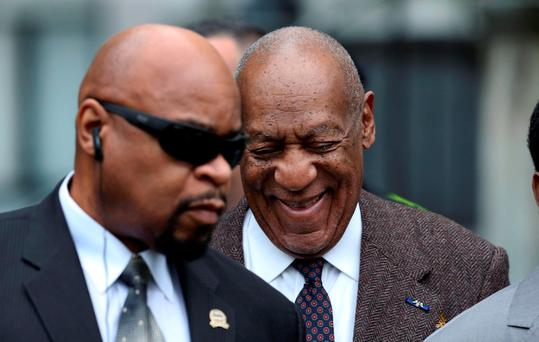 Bill Cosby, right, smiles as he arrives for a court appearance yesterday in Norristown, Pennsylvania. Photo: Mel Evans/AP Photo
