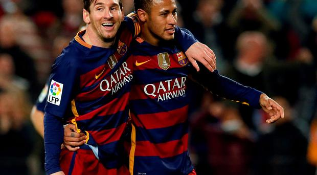 Barcelona's Neymar and Lionel Messi (L) celebrate a goal against Valencia. REUTERS/Albert Gea
