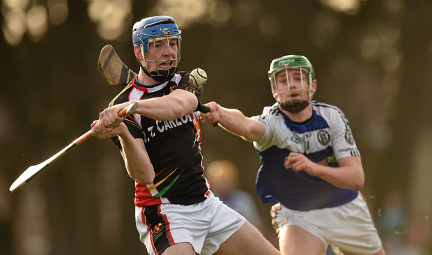 Stephen Maher, IT Carlow, in action against Niall Mullins, St Pat's (SPORTSFILE)