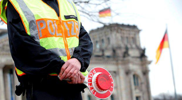 A German police officer stands outside the Reichstag, seat of the German lower house of Parliament Bundestag in Berlin, Germany