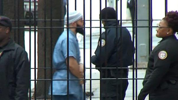 Adnan Syed, 35, who is serving a life term in prison after being convicted of murdering his 18-year-old ex-girlfriend in 1999, is shown in this still image from video footage as he is brought into Baltimore City Circuit Court in Baltimore, Maryland February 3, 2016