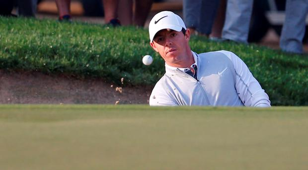 Rory McIlroy of Northern Ireland plays his third shot during the first round of the 2016 Dubai Desert Classic at the Emirates Golf Club in Dubai.