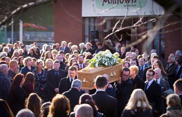 Family and friends gather at the funeral of Adam McCormack