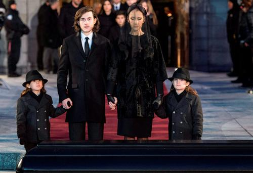Celine Dion leaves the church with her children, Rene-Charles, center left, and twins Eddy and Nelson after funeral services for her husband Rene Angelil, at Notre Dame Basilica Friday, Jan. 22, 2016 in Montreal. Angelil died Jan. 14, in Las Vegas at the age of 73. (Paul Chiasson/The Canadian Press via AP)