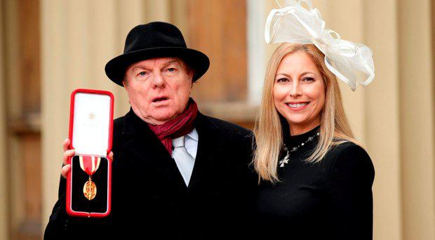 Singer, songwriter and musician Sir Van Morrison at Buckingham Palace, London, with daughter Shana Morrison after he was knighted by the Prince of Wales
