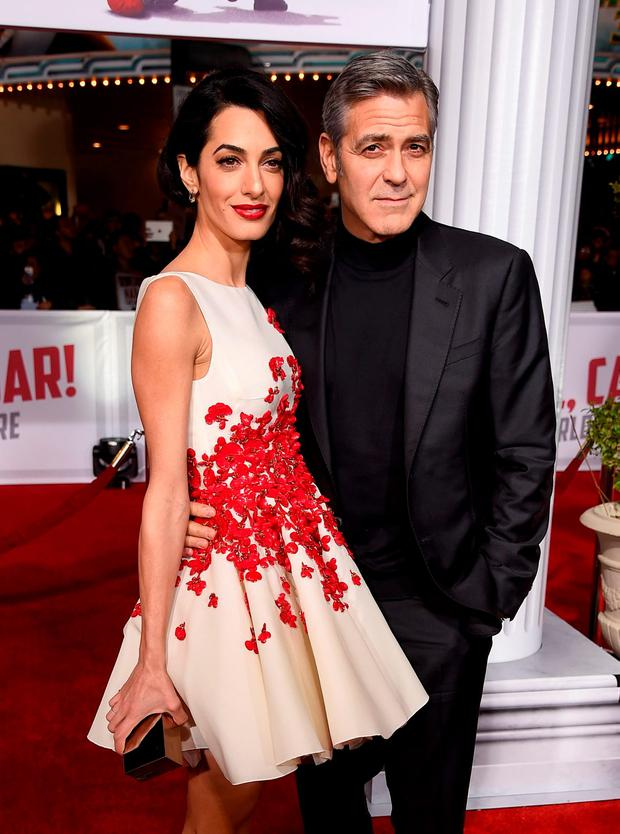 Actor George Clooney (R) and Amal Clooney