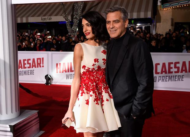 Actor George Clooney (R) and Amal Clooney attend Universal Pictures'