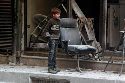 A boy inspects damage after airstrikes by pro-Syrian government forces in the rebel held Al-Shaar neighbourhood of Aleppo. Photo: Reuters