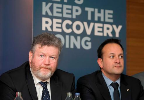 Minister for Children James Reilly and Minister for Health Leo Varadkar during an address to Fine Gael candidates by Enda Kenny. Minister Varadkar has defended shelving free GP care for all. Photo: Collins