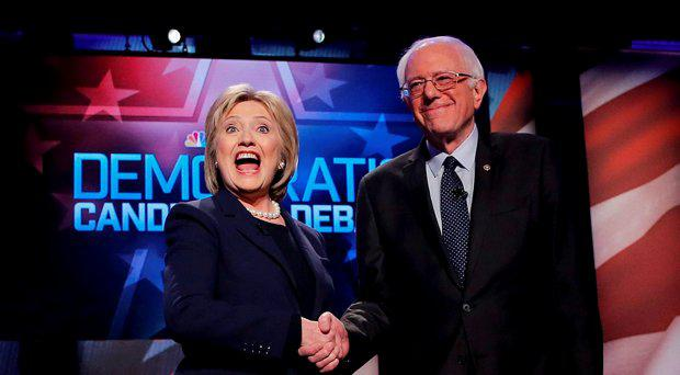 Democratic U.S. presidential candidates Hillary Clinton (L) and Bernie Sanders shake hands before the start of their presidential candidates debate sponsored by MSNBC at the University of New Hampshire in Durham, New Hampshire, February 4, 2016