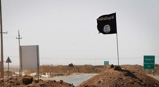 A flag of the Islamic State (Isis) is seen on the the frontline of fighting in Iraq