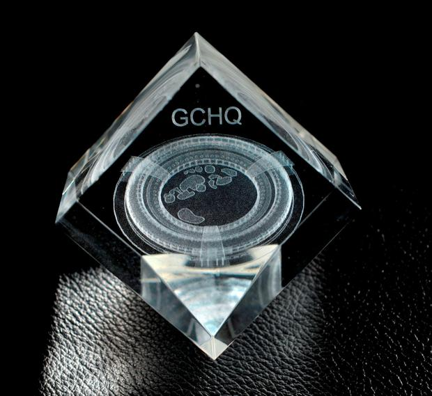 File photo dated 4/2/2016 of a paper weight issued by GCHQ for three amateur cryptographers who solved GCHQ's head-scratching Christmas puzzle, after they released a festive card last month featuring not reindeer or Father Christmas, but a cryptographic challenge