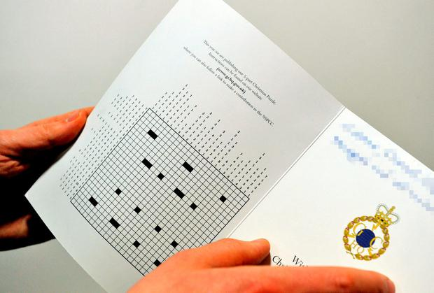File photo dated 4/2/2016 of the inside of GCHQ's head-scratching Christmas cryptographic challenge, released in their festive card last month, composed by two GCHQ cryptographers and which was successfully completed by just three amateur cryptographers