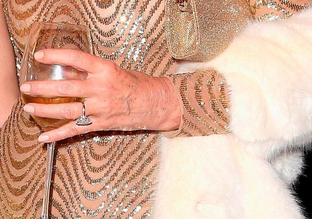 A close-up shot of her engagement ring from Rupert Murdoch, estimated to be worth €3m