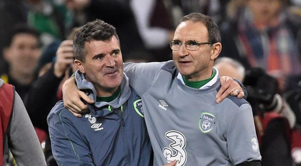 Roy Keane and Martin O'Neill embrace after securing qualification to Euro 2016