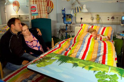Tyrone and Fiz in hospital with Hope. PIC: ITV