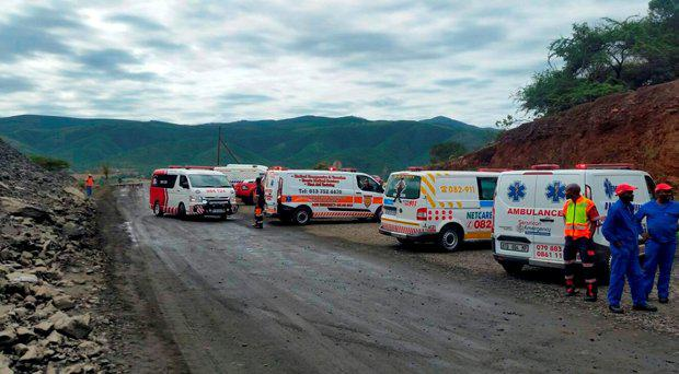 Rescue vehicles stand by at the scene of the Lily mine collapse near Barberton, February 5, 2016. Nearly 80 rescued miners were brought to the surface on Friday, police said, after about 115 were trapped underground following a collapse at the gold mine in northeastern South Africa earlier in the day