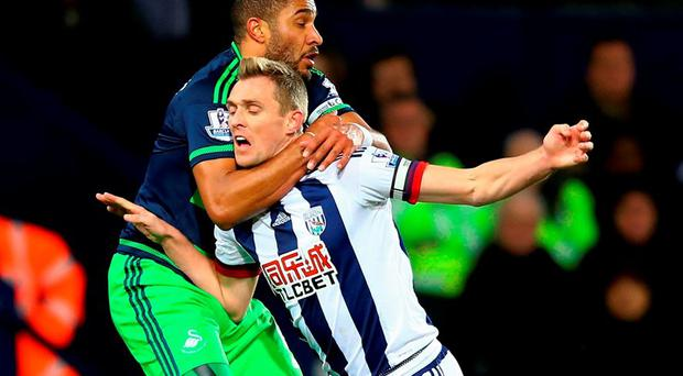 Darren Fletcher of West Bromwich Albion is challenged by Ashley Williams of Swansea City during the Barclays Premier League match between West Bromwich Albion and Swansea City at The Hawthorns on Tuesday