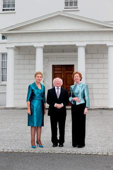 President Michael D. Higgins with former Presidents Mary Robinson and Mary McAleese outside Áras An Uachtaráin on the 75th anniversary of the Presidency in Ireland in 2013