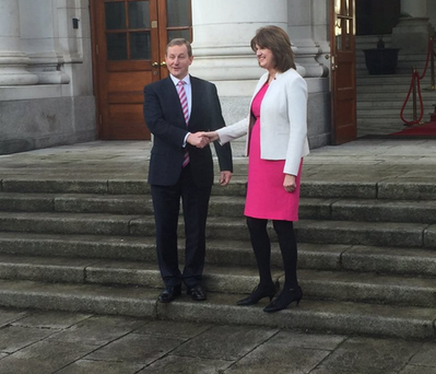 Enda Kenny and Joan Burton on the steps of Leinster House after the Dáil was dissolved. Photo: Twitter/ @CormacMcQuinn