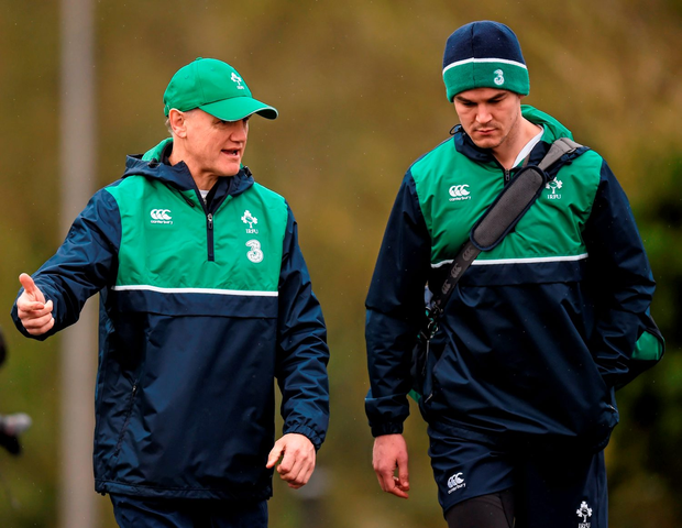 Ireland head coach Joe Schmidt deep in conversation with out-half Jonathan Sexton during squad training session at Carton House in Maynooth yesterday (SPORTSFILE)