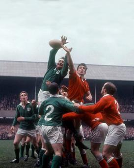 Legendary Ireland lock Willie John McBride palms the ball back in a line-out as Ken Goodall waits at the back at Lansdowne Road in 1968 (INPHO/Allsport)