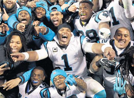 Carolina Panthers quarterback Cam Newton celebrates with team-mates after beating Arizona Cardinals