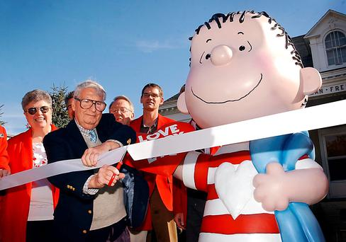 2003 file photo: The real Linus, artist Linus Maurer, cuts a ribbon after unveiling a statue of Linus of