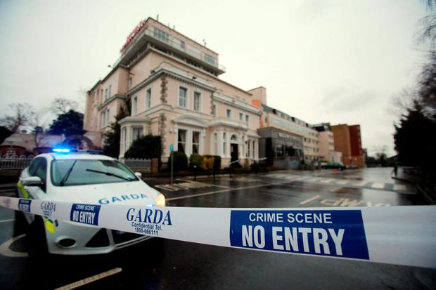 A Garda cordon outside the Regency Hotel in Dublin, as a major investigation was underway today after gunmen dressed up in police uniforms opened fire in the Irish hotel lobby, killing one man and seriously injuring two others, during a packed weigh-in for a European boxing title fight. Photo: Niall Carson/PA Wire