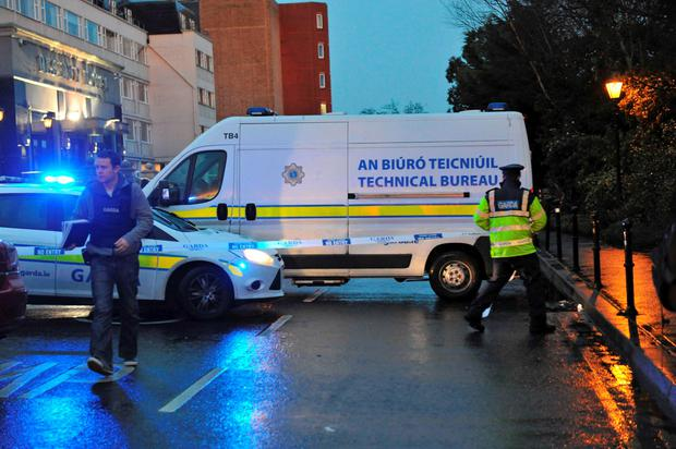 Police and forensic officers attend the scene of a shooting at the Regency Hotel in Dublin, Ireland. Reuters/Clodagh Kilcoyne