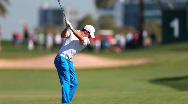 Rory McIlroy plays a shot during third round of the Dubai Desert Classic golf tournament in Dubai