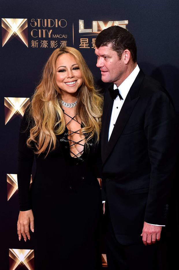 US singer Mariah Carey and co-chairman of Melco Crown Entertainment James Packer stand on the red carpet ahead of the opening ceremony of the Studio City casino resort in Macau