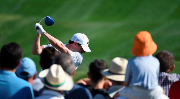 Rory McIlroy otees off on the first hole during the third round of the Omega Dubai Desert Classic on the Majlis course at the Emirates Golf Club