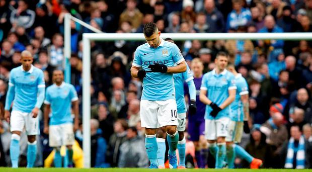 Manchester City's Sergio Aguero looks dejected following defeat to Leicester City