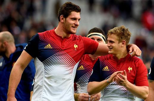 France's lock Alexandre Flanquart and out-half Jules Plisson celebrate after defeating Italy