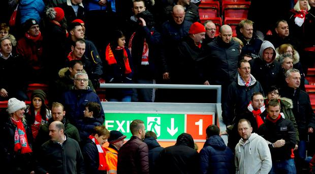 Liverpool fans exit the stadium on 77 minutes during the Barclays Premier League match at Anfield, Liverpool
