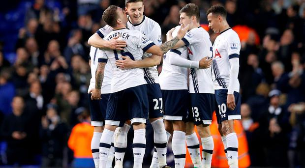 Tottenham Hotspur players celebrate winning after the game