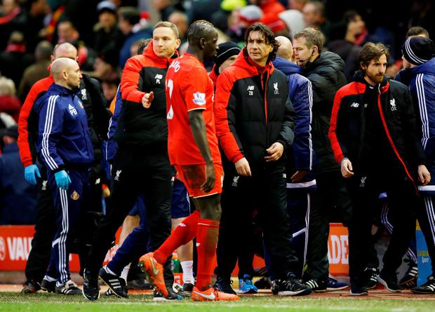 Liverpool coach Zeljko Buvac with Mamadou Sakho after the game