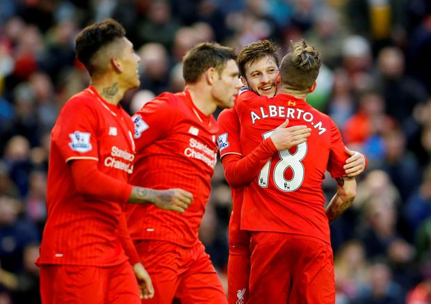 Adam Lallana celebrates after scoring the second goal for Liverpool
