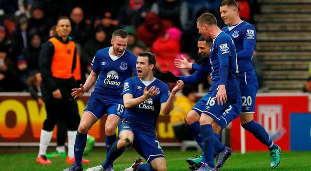 Seamus Coleman celebrates with teammates after scoring the second goal for Everton