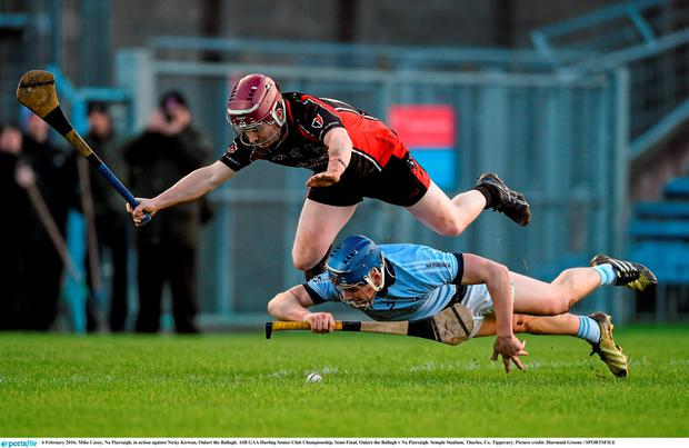 Mike Casey, Na Piarsaigh, in action against Nicky Kirwan, Oulart the Ballagh