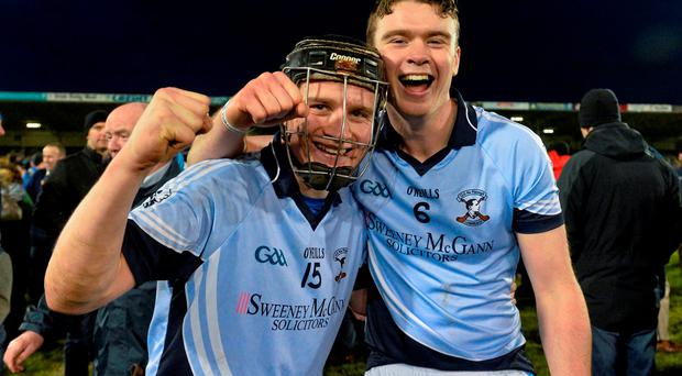 Peter Casey, left, and Ronan Lynch, Na Piarsaigh, celebrate after victory over Oulart the Ballagh