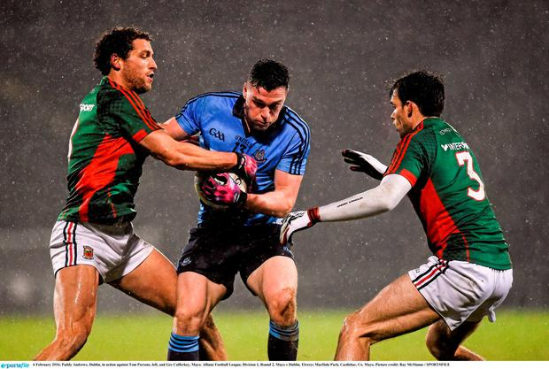 Paddy Andrews, Dublin, in action against Tom Parsons, left, and Ger Cafferkey, Mayo