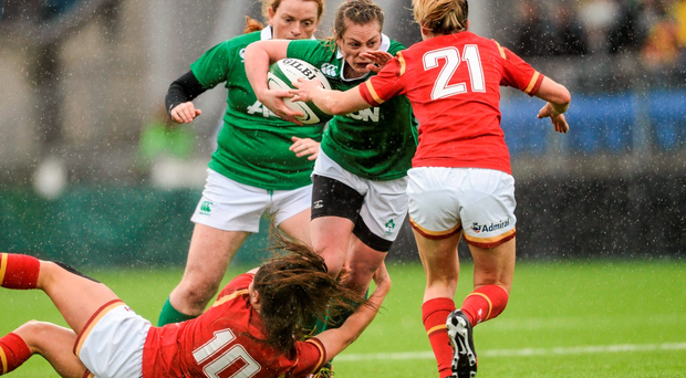 Ireland's Elise O'Byrne White is tackled by Robyn Wilkins and Elinor Snowsil of Wales. Picture credit: Paul Mohan / Sportsfile