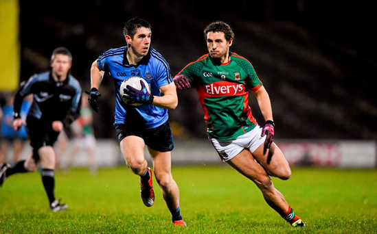 Dublin's Emmett Ó Conghaile in action against Mayo's Tom Parsons during last night's Allianz League game in Castlebar. Photo: Ray McManus