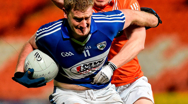 Donie Kingston, Laois, battles against Charlie Vernon of Armagh. Picture credit: Oliver McVeigh / Sportsfile