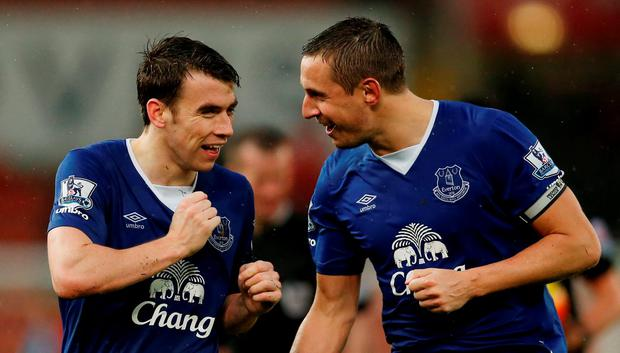 Everton's Seamus Coleman and Phil Jagielka celebrate winning after the game at the weekend. Photo: Reuters