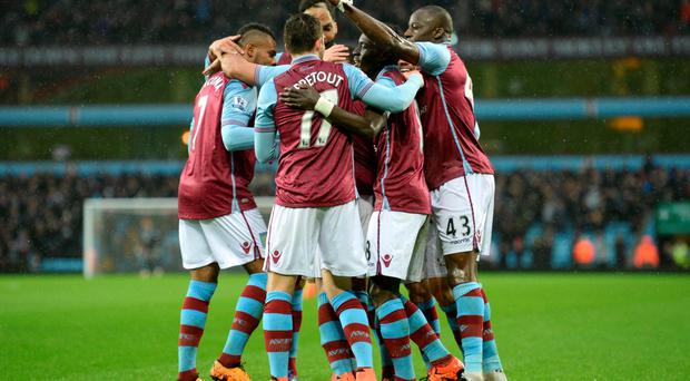 Aston Villa players celebrate following their second goal. Photo: Reuters